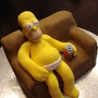 Homer Simpson On Couch My first attempt at a sculpted cake and 3D figure. It was a birthday cake for my fiancé.