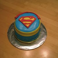 Superman Cake Surprise graduation cake for my Superman-loving friend. The cake was definitely a learning experience (lesson: fondant + humidity =...