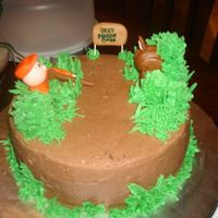 Deer Season Hunter Made for my friends hubby who is big on hunting, choco cake with choco BC fondant decroation