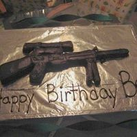 Sniper Rifle Cake chocolate cake shaped like a sniper rifle, i carved it out of a sheet cake