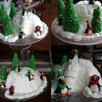 Penguins And Igloo I made this for a family Christmas party. The igloo was a holiday confetti cake covered with buttercream, marshmallows to make the door....