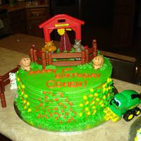 "Farm Birthday Cake First birthday cake with a John Deere Theme. I used a 10 "" round and added fisher price toys as decorations to save on time. I added &..."
