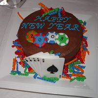 Poker New Year's Cake Chocolate Cake with Chocolate Icing. Fondant Cards, chips and streamers. I made this for a poker themed new years eve party.