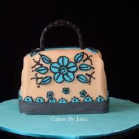 Purse Cake  I went to saks firth avenue website to see the lastest designs for purses. I made a hummingbird cake. Covered the fondant. I lost one cake...