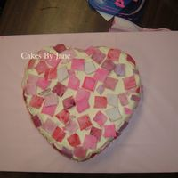 Mosaic Heart  I demonstrated this cake in front of my child's kindergarten class. They helped put on the fondant squares that I painted with luster...