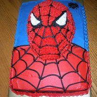 Spiderman egg pan face on top of 1/4 sheet. all buttercream.