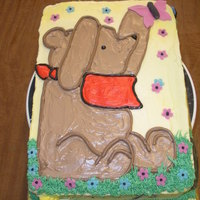 Classic Pooh   Yellow cake, covered with marshmallow buttercream. Fondant accents - flowers, honey pots, bees, hive, log, garden