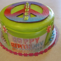 Peace Lauren This is a MMF covered cake with fondant/gumpaste decorations. The colors were done with the Wilton color mists.