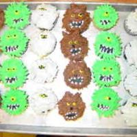 Halloween Cupcakes These were lots of fun to make. I got the ideas from many people here. They were for the school halloween carnival and were a big hit.