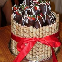 100_0578.jpg Chocoltae cake, buttercream frosting, chocolate ganache with pirouline coolies and chocolate dipped strawberries.