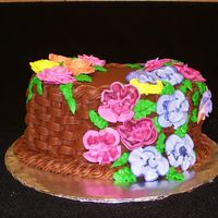Wilton Course 2 Final Chocolate cake with chocolate buttercream. My frist attempt at basket weave and flowers