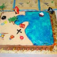 Pirate Cake I made this for my sons 6th birthday. Half strawberry, half chocolate cake with buttercream frosting. The sand is vanilla wafers and the...