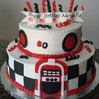 "Adrian's 50Th 50's Theme Birthday BC with fondant accents. Cakes are 12"" and 8"" x 3"""