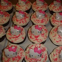 Hello Kitty Cupcakes / Cupcake Cake for my niece's 10th birthday.Chocolate cupcakes with buttercream frosting.