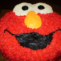 Elmo Birthday Cake Free-hand carving of Elmo's head, vanilla cake, vanilla buttercream. This was for a two-year old who loves the character!