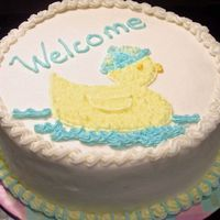 Ducky Baby Shower  Here's a quick cake I made for a friend. White cake with extender, plain BC. I tinted the filling blue for a surprise when they cut...