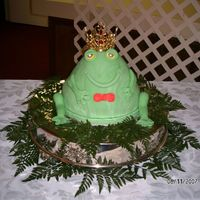 Froggie Goes A Courtin With His Crown This is my Frog dressed up in his crown and bow tie. He was the hitof the reception. People here aren't used to seeing fondant covered...