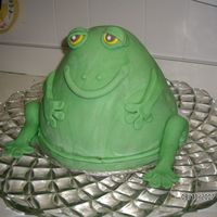"Froggie Goes A Courtin 10"" round and bell shaped pan covered in fondant. At the wedding he willhave a red sequin bow tie and a gold crown."