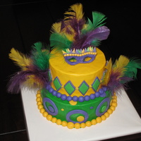 Mardi Gras Birthday Buttercream with fondant accents. Feathers were real though.