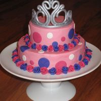 Tiara Cake Buttercream with MMF accents. Tiara was made using a clay gun and dried against a canister to get the shape. After it was dry, I painted it...