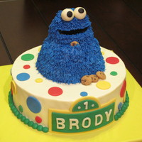 "Cookie Monster  Such a fun cake to make! Cookie is molded from Rice Krispie treats and frosted using the ""grass"" tip. Cake has buttercream..."