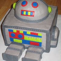 "Robot Iced in Buttercream with MMF accents. Used 4, 8"" square cakes for body, 6"" round & Ball pan for head, and mini loaf pan for..."