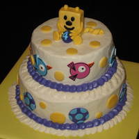 Wow Wow Wubbzy Cake Wubbzy cake done with buttercream and MMF accents. Tiers have things from the show that the birthday girl particular loved. Lots of fun!