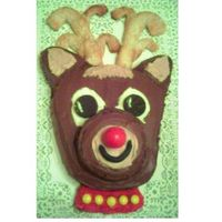 Reindeer Cake  I saw this Woman's World magazine. I made 5 of these this week! Whew! Big Big hit though. The antlers are refridgerated bread sticks...