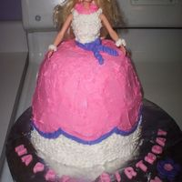 Barbie Cake this was hard because Barbie is so tall I kept having to add layers to the bottom so it ate into my profits. she is purple and pind...