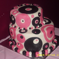 Ya Got Me Going In Circles A birthday cake for a young ladyall fondant.I am still learning please feel free to give me any constructive criticism