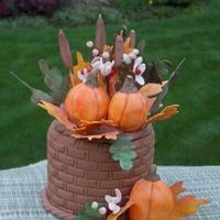 Gumpaste Fall Arrangement GP pumpkins, leaves, bittersweet, cattails. Basket is styrofoam, covered with GP