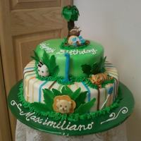 Jungle Theme Cake  Two-tiered jungle themed cake for a 1-year old. I made each animal out of fondant/gumpaste. I used the theme from the napkins and plates. I...