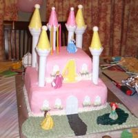 Disney Princess Castle Cake I did this cake for my daughter's 4th birthday. Buttercream icing with brick impression mats used. I used the Wilton Castle kit and...