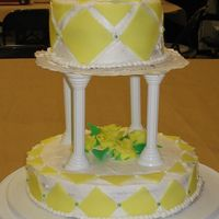 Final_Project_007.jpg 2 tiered cake with fondant decorations and flowers.