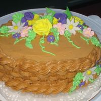 Flower Basket Oval cake with basket weave and royal icing flowers.