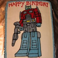 Transformers   Buttercream icing with hand drawn design.