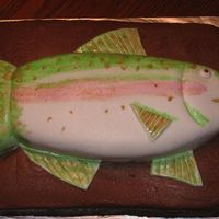 Rainbow Trout   Quarter sheet cake with Chocolate BC frosting. Fish is covered in MMF and painted by hand. First attempt at that! Very fun.