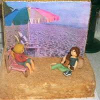 Beach Scene This is the back side of the cake I made for the Hannah Montana cake. It's a beach scene as you can tell with Miley and Lilly. It&#039...
