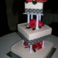 Cakes_004.jpg 1st square wedding cake. white cake ivory icing, black ribbon, fresh flowers