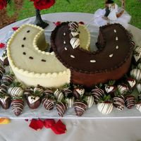 Grooms Cake Chocolate sludge cake horseshoes covered in white and dark ganacje with chocolate dipped strawberries.