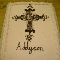 Cross Cake white and buttercream cake with chocolate piped cross.
