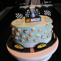Nascar Cake Design taken from Wilton 2007 yearbook. Made for my nephew, who requested banana cake. I added cream cheese frosting, and banana/vanilla...