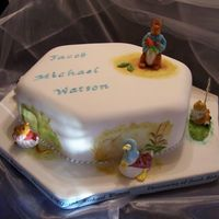 100_0211.jpg Peter Rabbit and friends Christening cake Peter Rabbit and friends hand made in sugar paste and modeling paste. Cake hand painted for my...