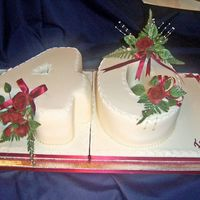 101_0076_Edited.jpg Fruit cake covered in regal ice and the roses were also hand made with flower paste it was made for a friends big 40