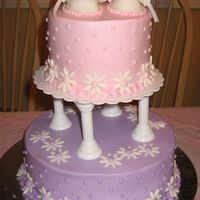Girl Baby Shower Cake has fondant daisies and booties, etc.