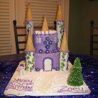 Princess Castle Cake This is a Princess Castle cake with Snow since Zoey's Birthday is right before Christmas. The cake is a 9inch round on bottom with a...