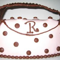 Purse.jpg This is a strawberry cake with Strawberry Marshmallow fodant and chocolate buttercream accents. This is my first purse cake and I learned a...