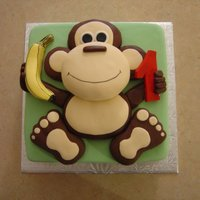 Going Bananas!! Square cake with monkey. Monkey is made of Rice Krispies and covered in chocolate fondant.