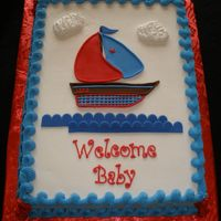 "Sailboat Baby Shower Made to match baby bedding. I put the baby's name ""Lane"" on the boat. Buttercream with fondant accents."