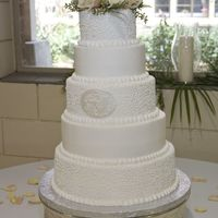 Monogram Wedding Cake Replacing picture of naked cake already posted. Photographer sent me a picture of cake after the florist placed the flower topper. All...
